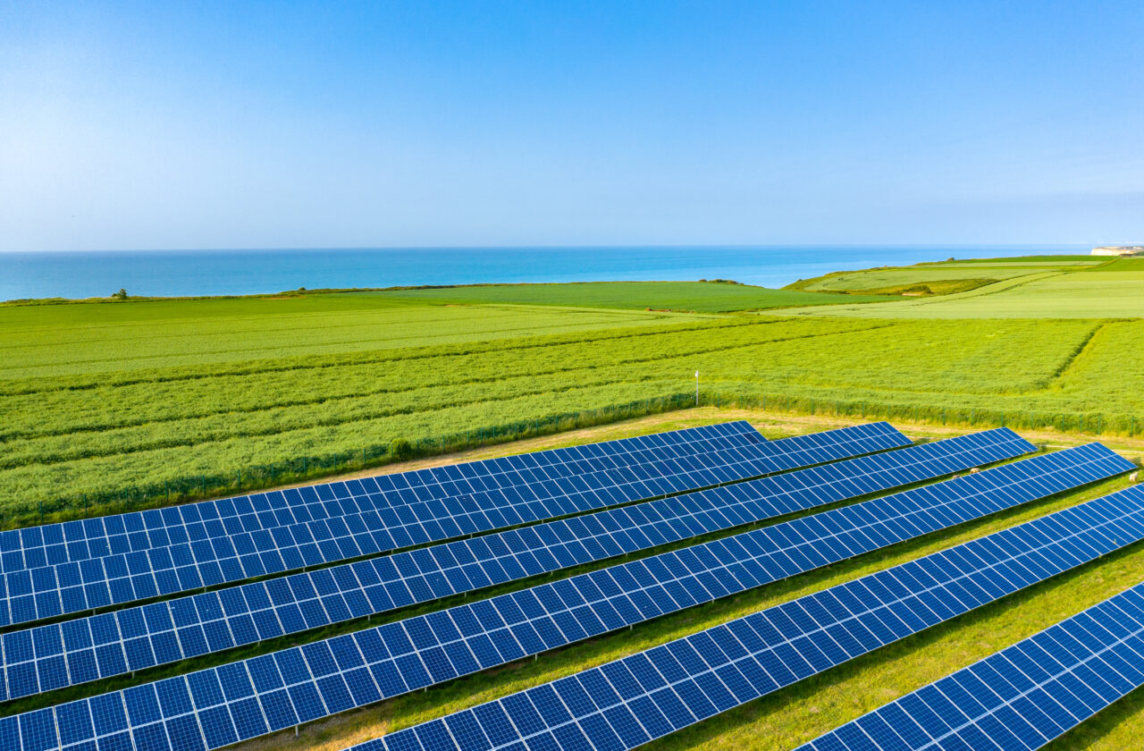 Fields of solar panels and linen by the sea.